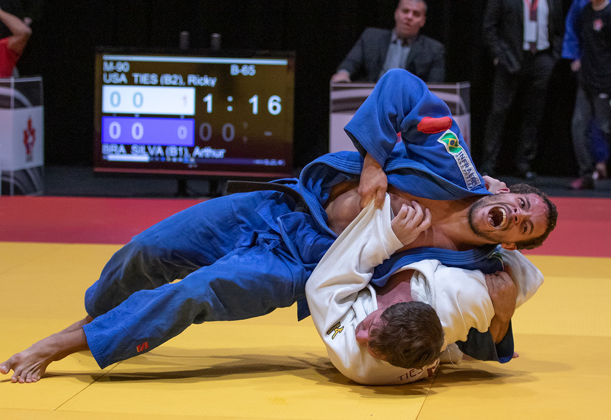 Two judoka with visual impairments grapple on the mat at the Baku 2019 Grand Prix