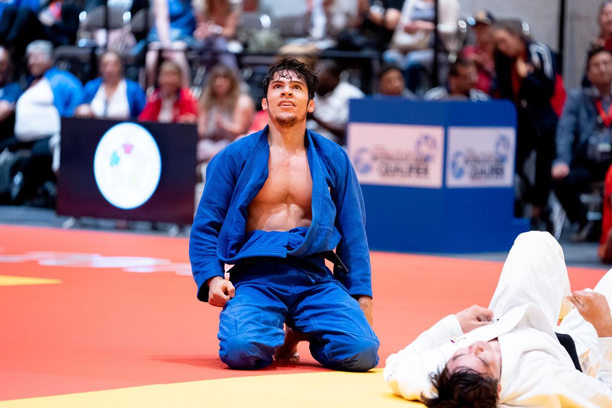 Eduardo Avila Sanchez of Mexico kneels on the mat and gazes at the sky